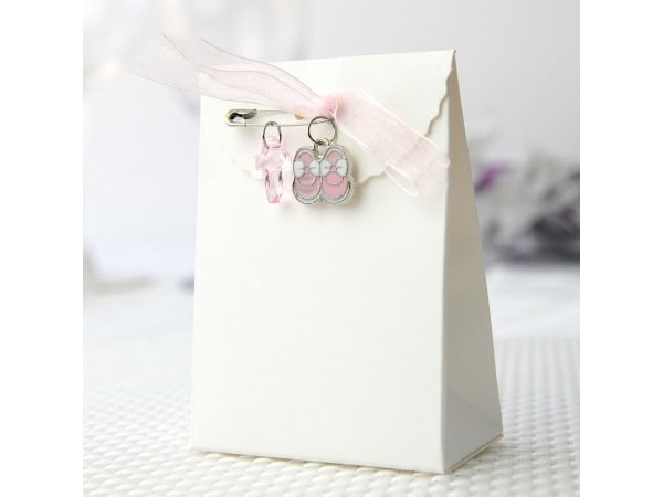 Imperdible con cruz+lazo+botitas rosa