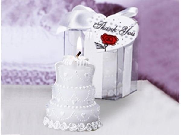 Detalle de boda vela pastel novios
